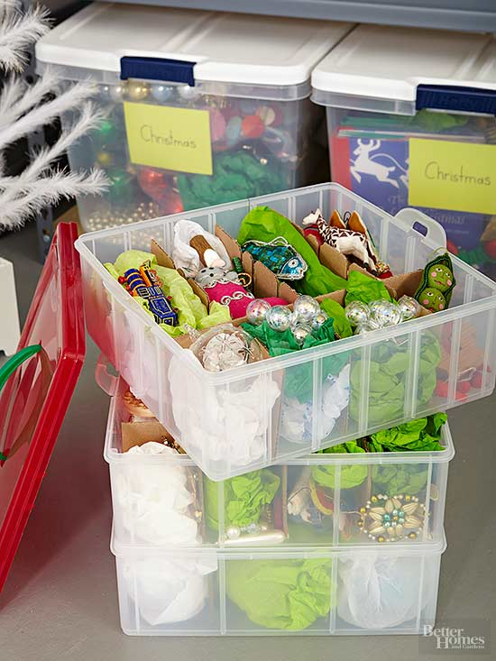plastic Christmas ornament storage bin with ornaments wrapped in tissue paper